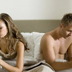 Young couple using smart phones in bed --- Image by © Steve Sparrow/cultura/Corbis